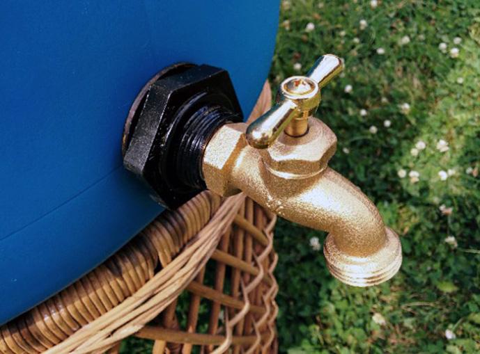Bottom spigot on a classic rain barrel.